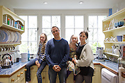 The Elliott family in their kitchen. From left to right: Molly Elliott (10), Richard Elliott, Milly-grace (8),  Tracey Elliott. Pickwell Manor, Georgeham, North Devon, UK.<br /> CREDIT: Vanessa Berberian for The Wall Street Journal<br /> HOUSESHARE