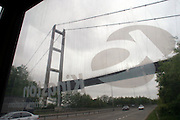 Humber bridge from the inside of a white telephone box operated by Kingston Communications formerly The Hull City Telephone Department of the City Council....