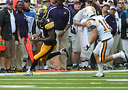 September 3, 2011: Iowa Hawkeyes wide receiver Marvin McNutt (7) runs after a catch as Tennessee Tech Golden Eagles cornerback Taylor Hennigan (10) closes in during the first half of the game between the Tennessee Tech Golden Eagles and the Iowa Hawkeyes at Kinnick Stadium in Iowa City, Iowa on Saturday, September 3, 2011. Iowa defeated Tennessee Tech 34-7 in a game stopped at one point due to lightning and rain.