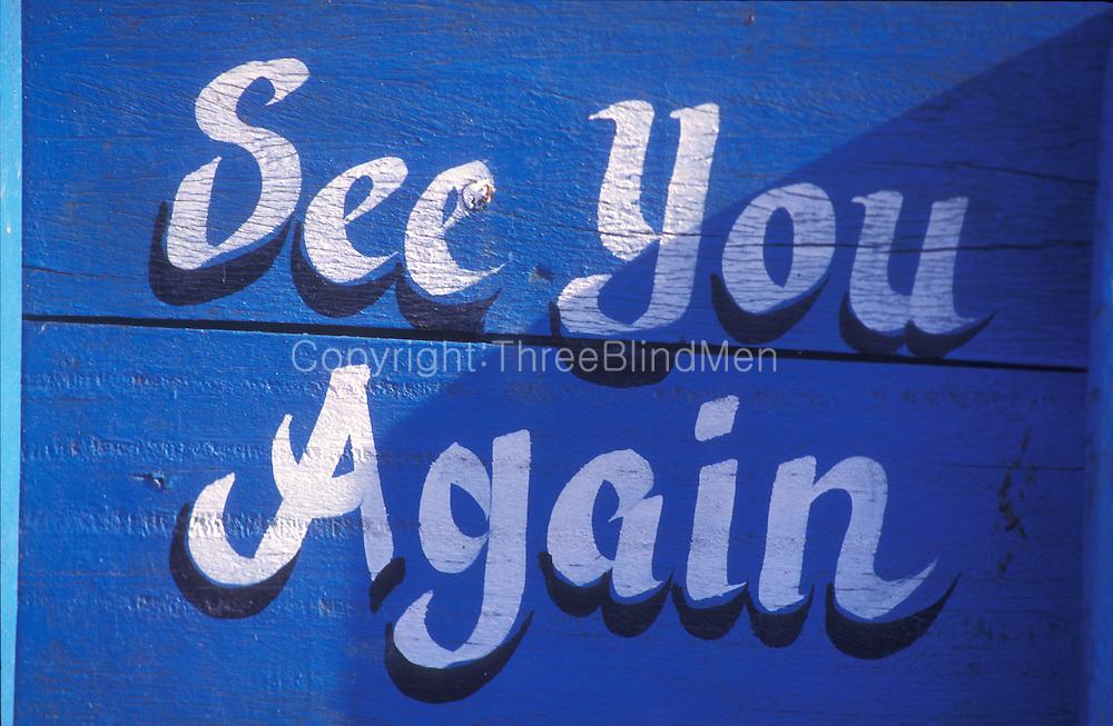 Painted sign board at Unuwatuna beach.