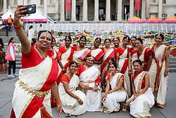 © Licensed to London News Pictures. 03/11/2019. London, UK. Dancers in colourful saris and costumes takes a selfie during the Diwali celebrations in London's Trafalgar Square. Hundreds of Hindus, Sikhs, Jains and people from all communities attend Diwali celebrations in London's Trafalgar Square. Diwali s celebrated each year with a free concert of traditional, religious and contemporary Asian music and dance. Photo credit: Dinendra Haria/LNP