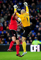 Cardiff City's Heidar Helguson and Peterborough United's Robert Olejnik battles for the ball in the air - Photo mandatory by-line: Dougie Allward/JMP  - Tel: Mobile:07966 386802 15/12/2012 - SPORT - FOOTBALL -  Championship -  Cardiff-  New Cardiff City Stadium  -  Cardiff City v Peterborough United