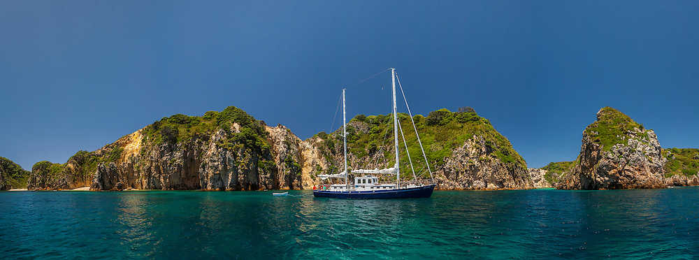 Seni Loka anchored at Arch Rock in the Flax Islands.  Mokohinau islands.  Panorama is 12 x images stitched together in photoshop.
