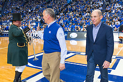 After being acknowledged for sponsoring the game during halftime by UK President Eli Capilouto, right, Keeneland President Bill Thomasson, center, high-fives Keeneland Track Bugler Steve Buttleman. <br /> <br /> The University of Kentucky hosted the LSU Tigers, Saturday, March 05, 2016 at Rupp Arena in Lexington .