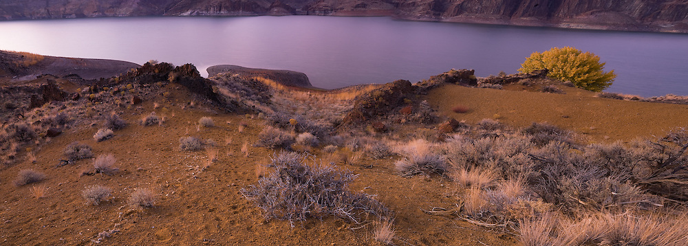 Volcanic formations surround the rugged lake shore of Lake Owyhee State Park, Oregon.