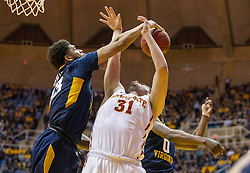 Feb 22, 2016; Morgantown, WV, USA;  Iowa State Cyclones forward Georges Niang (31) is blocked by West Virginia Mountaineers forward Esa Ahmad (23) during the first half at the WVU Coliseum. Mandatory Credit: Ben Queen-USA TODAY Sports