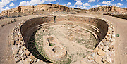 Large stone kiva for Puebloan religious rituals. Chetro Ketl was a massive stone building (Puebloan Great House) occupied from 950-1250s AD, now preserved at Chaco Culture National Historical Park, New Mexico, USA. This park hosts the densest and most exceptional concentration of pueblos in the American Southwest and is a UNESCO World Heritage Site. Chaco Canyon is in remote northwestern New Mexico, between Albuquerque and Farmington, USA. From 850 AD to 1250 AD, Chaco Canyon advanced then declined as a major center of culture for the Ancient Pueblo Peoples. Chacoans quarried sandstone blocks and hauled timber from great distances, assembling fifteen major complexes that remained the largest buildings in North America until the 1800s. Climate change may have led to its abandonment, beginning with a 50-year drought starting in 1130. This panorama was stitched from 8 overlapping photos.