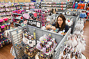 ROGERS, AR - OCTOBER 12:  Associate Esmeralda Gonzalez arrange bras and underwear in the Intimate Department at Walmart Store #4208 on October 12, 2015 in Rogers, Arkansas.  <br /> CREDIT Wesley Hitt for Wall Street Journal<br /> WALSQUEEZE