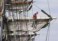 KEVIN BARTRAM/The Daily News.A crew member works high above the deck of the 1877 iron barque Elissa at the Port of Galveston on Monday, March 27, 2006. Last year the Texas legislature named the ship the Official Tall Ship of Texas. The ship is owned and operated by the Galveston Historical Foundation and is sailing daily as part of annual sea trials.