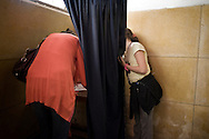 EGYPT, Cairo : Egyptians women up to vote in Cairo on March 19, 2011 as voters got their first taste of democracy in a referendum to a package of constitutional changes after president Hosni Mubarak was forced to relinquish his 30-year grip on power last month in the face of mass street protests. ALESSIO ROMENZI