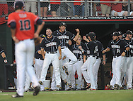 Louisiana-Lafayette celebrates a home run by Louisiana-Lafayette's Tyler Girouard (9) as Mississippi's Chris Ellis (10) looks over in an NCAA Super Regional game in Lafayette, La. on Saturday, June 7, 2014.