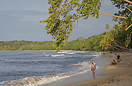 Tourists on main beach, Cahuita National Park, Caribbean coast, Costa Rica.<br /> <br /> For pricing click on ADD TO CART (above). We accept payments via PayPal.