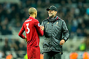 Liverpool manager Jurgen Klopp celebrates with Fabinho (#3) of Liverpool following Liverpool's victory in the Premier League match between Newcastle United and Liverpool at St. James's Park, Newcastle, England on 4 May 2019.