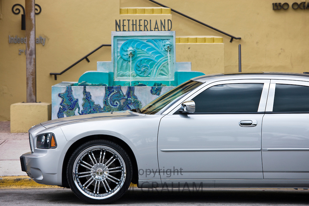 Dodge Charger in front of Netherland condo in Ocean Drive, South Beach, Miami, Florida, USA