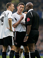 Photo: Dave Howarth.<br /> Everton v Charlton Athletic. The Barclays Premiership.<br /> 02/01/2005.  Charlton's Dennis Rommedahl and Matt Holland argue their case against the everton penalty