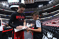 November 2, 2018 - Chicago, IL, USA - Chicago Bulls guard Ryan Arcidiacono signs an autograph before a game against the Indiana Pacers at the United Center in Chicago on Friday, Nov., 2, 2018. The Pacers won, 107-105. (Credit Image: © John J. Kim/Chicago Tribune/TNS via ZUMA Wire)
