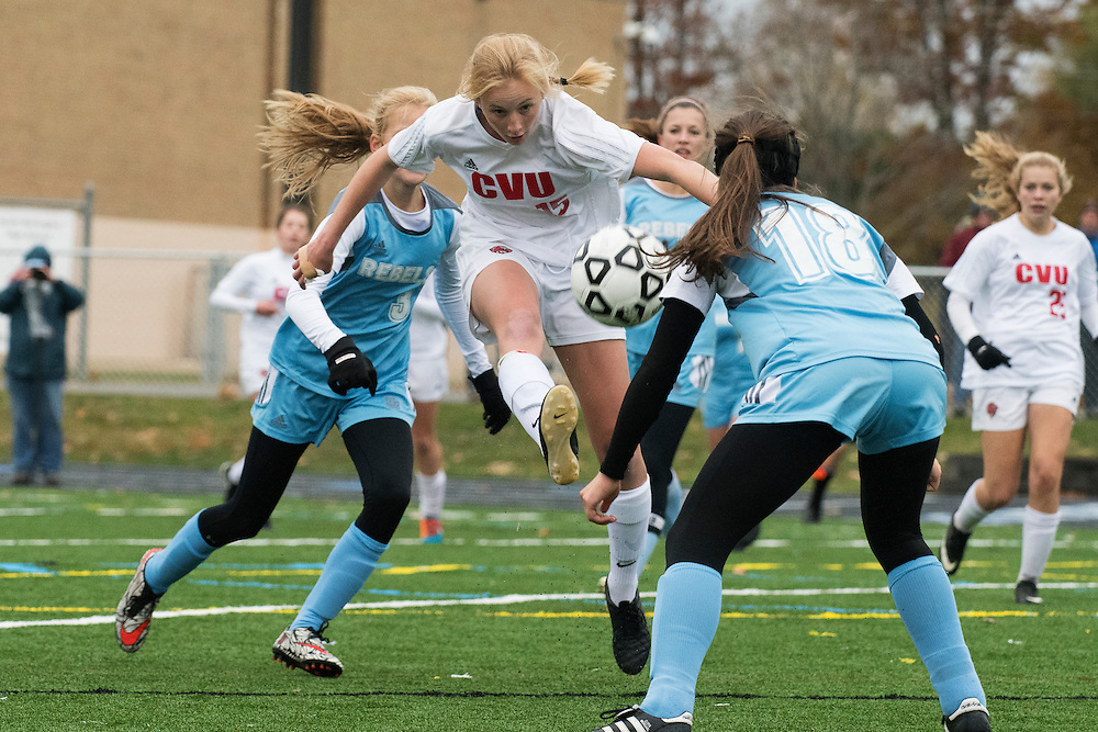 CVU's Sierra Morton (15) leaps to kick the ball during the girls high school playoff game between the Champlain Valley Union Redhawks and the South Burlington Rebels at South Burlington High School on Saturday afternoon October 29, 2016 in South Burlington. (BRIAN JENKINS/for the FREE PRESS)