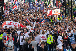 © Licensed to London News Pictures. 13/10/2018. London, UK. The Democratic Football Lads Alliance hold a march in Central London. Strict conditions have been imposed upon the march to prevent 'serious disorder' following previous demonstrations. A counter demonstration organised by Stand Up To Racism and Unite Against Fascism is being held in Westminster. Photo credit : Tom Nicholson/LNP