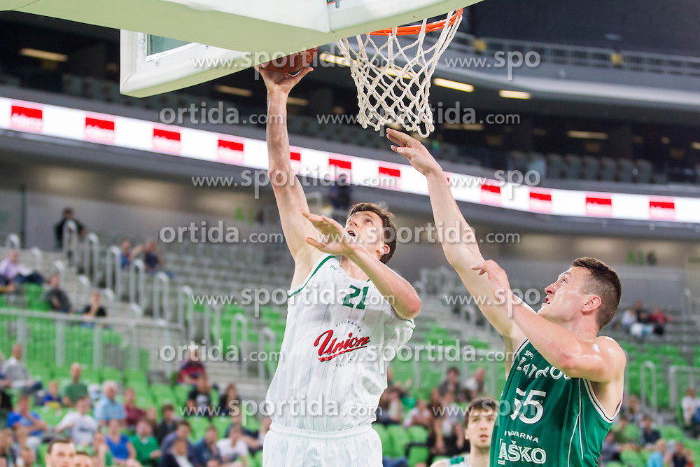 Blaz Mahkovic #21 of KK Union Olimpija and Jakob Cebasek #55 of KK Zlatorog Lasko during basketball match between KK Union Olimpija and KK Zlatorog Lasko in semi-final of Nova KBM Champions League 2015/16, on May 23, 2016 in SRC Stozice, Ljubljana, Slovenia. Photo by Urban Urbanc / Sportida