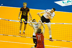 09.01.2016, Max Schmeling Halle, Berlin, GER, CEV Olympia Qualifikation, Deutschland vs Russland, im Bild Marcus Boehme (#8, GER) gegen Andrey Ashchev (#11, RUS) // during 2016 CEV Volleyball European Olympic Qualification Match between Germany and Russia at the Max Schmeling Halle in Berlin, Germany on 2016/01/09. EXPA Pictures © 2016, PhotoCredit: EXPA/ Eibner-Pressefoto/ Wuechner<br /> <br /> *****ATTENTION - OUT of GER*****