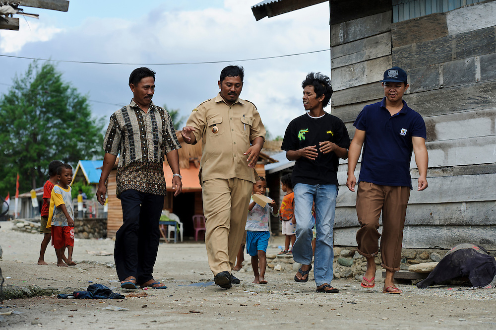 YASALU staff discussing beach erosion and land use with the Kepala Desa, Ogotion, Central Sulawesi, Sulawesi, Indonesia.