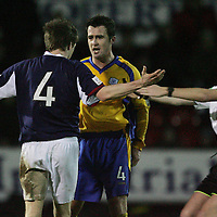 Ross Cty v St Johnstone..03.01.05<br />Ref Calum Murray moves in to separate David Hannah and Fergus Tiernan<br /><br />Picture by Graeme Hart.<br />Copyright Perthshire Picture Agency<br />Tel: 01738 623350  Mobile: 07990 594431