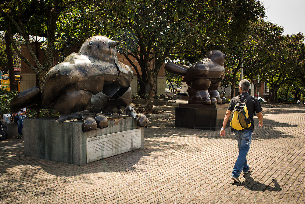 "2015/11/20- Medellín, Colombia: The past and present of Medellín. These two bird made by Colombian contemporary artist Fernando Botero, represent the history of the city. The one on the left was damaged after a bombed went off on the 10th of June 1995 killing 30 people. Even if Pablo Escobar was dead the violence continued.   Tours focusing on the life and death of Pablo Escobar are becoming quite popular among international tourists that visit Medellín. In recent times more than 10 tour operators have started to give the tour, helped by the interest generated by Netflix ""Narcos"" series. (Eduardo Leal)"