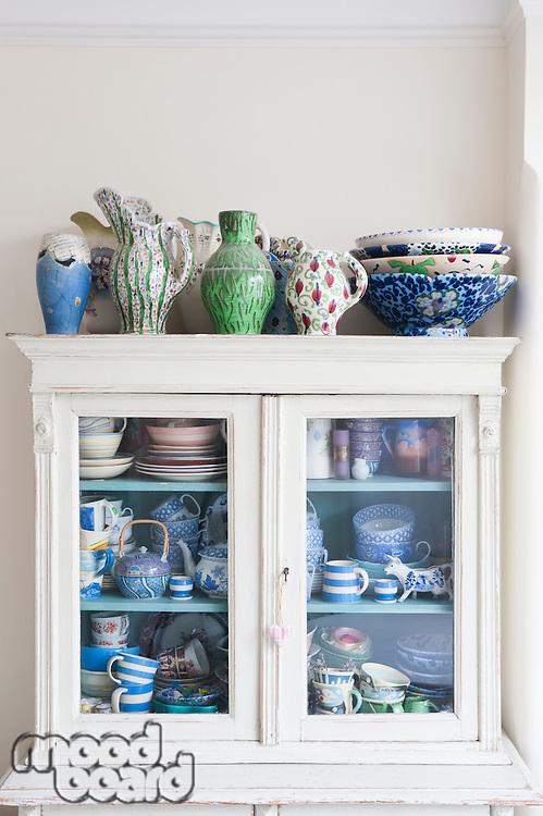 Storage cabinet with crockery