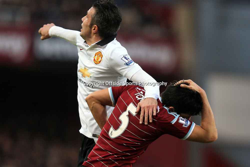 8 February 2015 - Barclays Premier League - West Ham United v Manchester United - Robin van Persie of Manchester United elbows James Tomkins of West Ham - Photo: Marc Atkins / Offside.