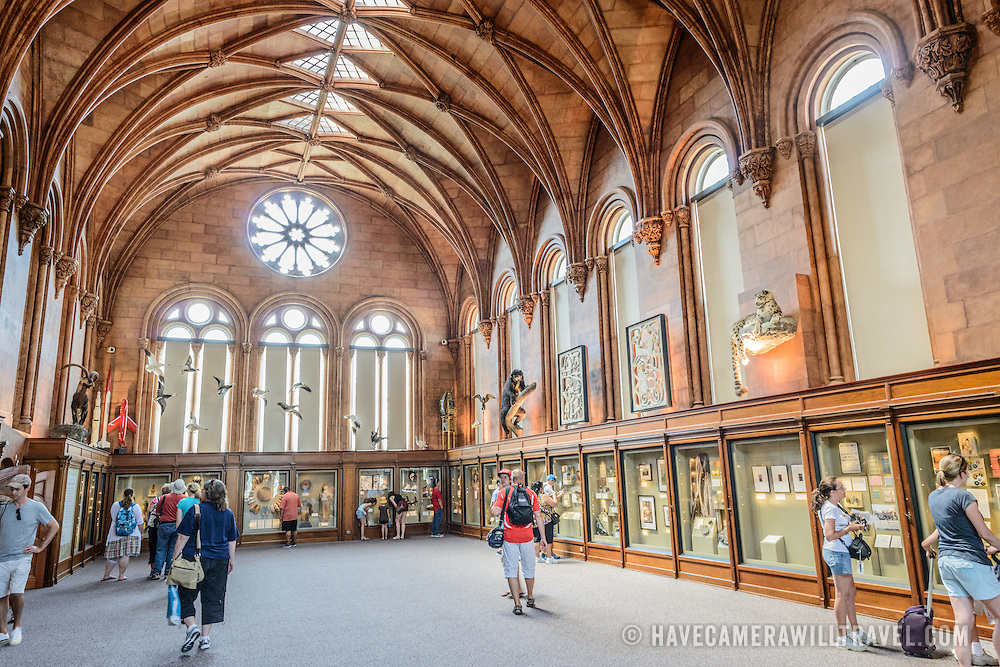 Smithsonian Castle West Wing Exhibit Hall. The large West Wing exhibit hall inside the Smithsonian Castle. Formally known as the Smithsonian Institution Building, the Smithsonian Castle houses the administrative headquarters fo the Smithsonian Institution as well as some a permanent exhibition titled Smithsonian Institution: America's Treasure Chest. It's distinctive architectural style stands out on the southern side of the National Mall in Washington DC.