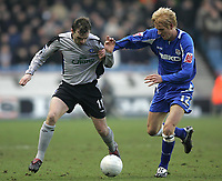 Photo: Lee Earle.<br /> Millwall v Everton. The FA Cup. 07/01/2006. Everton's James McFadden (L) battles with Zak Whitbread.