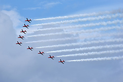 © Licensed to London News Pictures.  03/06/2017; Torbay, Devon, UK. Torbay Airshow 2017. The RED ARROWS perform their first display of the season with a new routine at the 2017 Torbay Airshow. The 2017 Torbay Airshow returns this weekend on Saturday 3 and Sunday 4 June with an action packed programme of world class air displays. The world's premier aerobatic team The Red Arrows will be debuting a new routine in the first display of their season, featuring their trademark combination of close formations and precision flying. The full display programme for the weekend begins on the Saturday between 2-3pm with The Tigers Freefall Parachute Display Team, Team Raven Aerobatic Display Team, the Percival Piston Provost and the Strikemaster. From 3-4pm will be the highly anticipated display by the Red Arrows, former British Female Aerobatic Champion Lauren Richardson in her Pitts Special S1-S and world aerobatic competitor Gerald Cooper in his Xtreme XA41. Finishing off the action packed afternoon from 4-5pm will see displays from the AutoGyro, the Battle of Britain Memorial Flight aircraft, the PBY5A Catalina seaplane, The Blades and the Royal Air Force's Typhoon FGR4. Sunday afternoon will see each of the aircraft take to the skies again before the weekend closes with a final display from the RAF Chinook team. The two day show, which had its inaugural event last year, takes place on Paignton Green with the Bay providing a stunning natural amphitheatre for viewing the air displays and the perfect location for a large coastal airshow event. To stay up to date with the latest Torbay Airshow news and updates follow @torbayairshow on Facebook, Twitter and Instagram or visit www.torbayairshow.com. Picture credit : Simon Chapman/LNP