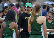 Nov 1, 2017; Long Beach, CA, USA; Long Beach Poly girls coach Natan Bershtel talks with runners before the start of the varsity race during the Moore League cross country finals at Heartwell Park.