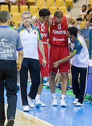 Injured Erden Semih of Turkey during friendly match between National teams of Slovenia and Turkey for Eurobasket 2013 on August 4, 2013 in Arena Zlatorog, Celje, Slovenia. (Photo by Vid Ponikvar / Sportida.com)