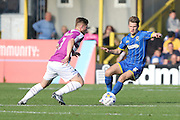 Jake Reeves of AFC Wimbledon and Elliot Johnson during the Sky Bet League 2 match between AFC Wimbledon and Barnet at the Cherry Red Records Stadium, Kingston, England on 3 October 2015. Photo by Stuart Butcher.
