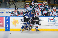 KELOWNA, CANADA - MARCH 11: Chaz Reddekopp #29 of Victoria Royals checks Nick Merkley #10 of Kelowna Rockets in front of the bench on March 11, 2015 at Prospera Place in Kelowna, British Columbia, Canada.  (Photo by Marissa Baecker/Shoot the Breeze)  *** Local Caption *** Chaz Reddekopp; Nick Merkley;