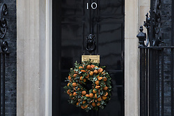 London, UK. 16 December, 2019. A Christmas wreath hangs outside 10 Downing Street on the day of a small Cabinet reshuffle following the Conservatives' general election victory.