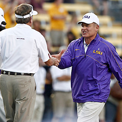 October 13, 2012; Baton Rouge, LA, USA; South Carolina Gamecocks head coach Steve Spurrier  and LSU Tigers head coach Les Miles prior to kickoff of a game at Tiger Stadium.  Mandatory Credit: Derick E. Hingle-US PRESSWIRE