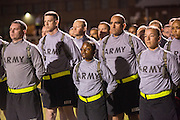 Male and female Drill Sergeant candidates at the US Army Drill Instructors School line up before taking their physical training test early morning September 27, 2013 in Columbia, SC. While 14 percent of the Army is women soldiers there is a shortage of female Drill Sergeants.