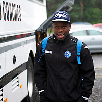 St Johnstone v Eskisehirspor....18.07.12  Uefa Cup Qualifyer<br /> Nigel Hasselbaink all smiles as he arrives at a very wet McDiarmid Park en-route to Edinburgh Airport<br /> Picture by Graeme Hart.<br /> Copyright Perthshire Picture Agency<br /> Tel: 01738 623350  Mobile: 07990 594431