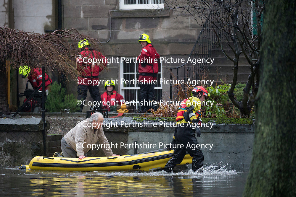Heavy Rain and More Flooding Continues in Perthshire….05.01.16<br />Marshall Place in Perth was the scene for extensive flooding this morning after continuing rainfall and very high water levels in the nearby River Tay forced the drains to backup leading to widespread floods. A few homeowners opted to be rescued by firefighters with boats, but most opted to stay put.<br />An elderly man is transported by firefighters on a rescue sled on Marshall Place<br />Picture by Graeme Hart.<br />Copyright Perthshire Picture Agency<br />Tel: 01738 623350  Mobile: 07990 594431