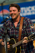 Country music singer Chris Young performs before the start of the NASCAR Sprint Cup Series Quaker State 400 at Kentucky Speedway in Sparta, Kentucky on June 30, 2012.