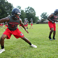 Nettleton's Marcus Thomas goes through drills with his team on Wednesday.