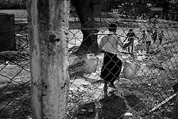 People getting water. At Dala, Yangon Division, Myanmar, 16th February, 2014.