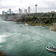 The Maid of the Mist carrying tourists sets off at Niagara Falls on the Niagara River on the border between the United States and Canada.