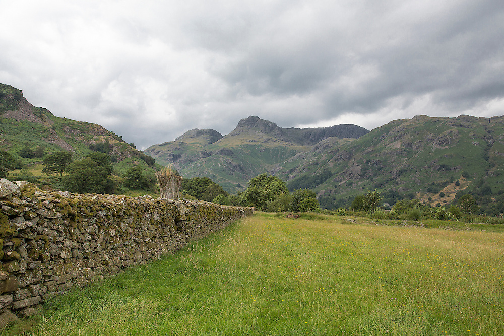 A view of the Langdale Valley in the English Lake District with a dry stone wall