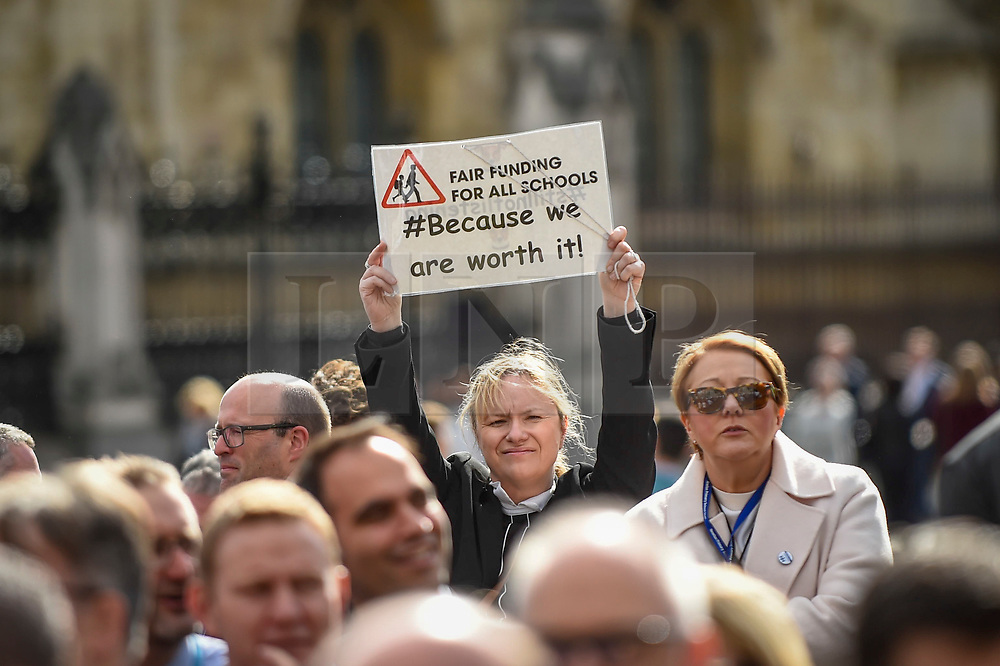© Licensed to London News Pictures. 28/09/2018. LONDON, UK. A head teacher with her placard joins hundreds of other head teachers at a rally in Parliament Square to demand extra funding for schools ahead of a petition being delivered to Number 11 Downing Street.  With a reported reduction in per student funding in real terms since 2010, members of the National Union of Head Teachers and the Association of School and College Leaders attending the rally also warn of increasing class sizes, staff cuts, and reduced subject choice.  Photo credit: Stephen Chung/LNP