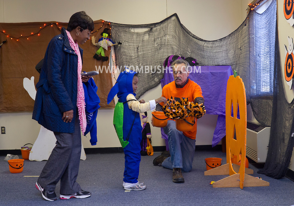 Middletown, New York  - A child picks a prize after playing a game at the Halloween Fall Festival at the Middletown YMCA's Center for Youth Programs on Oct. 25, 2014.
