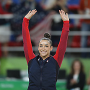 Gymnastics - Olympics: Day 6  Alexandra Raisman #395 of the United States waves to the crowd on the podium before receiving her silver medal during the Artistic Gymnastics Women's Individual All-Around Final at the Rio Olympic Arena on August 11, 2016 in Rio de Janeiro, Brazil. (Photo by Tim Clayton/Corbis via Getty Images)