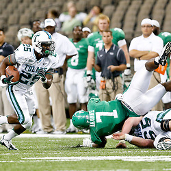 Oct 5, 2013; New Orleans, LA, USA; Tulane Green Wave running back Josh Rounds (25) runs against the North Texas Mean Green during the second half at Mercedes-Benz Superdome. Tulane defeated North Texas 24-21. Mandatory Credit: Derick E. Hingle-USA TODAY Sports